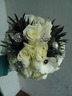 grouped bouquet of roses, thistle, gerberas & carnations with brooch detailing for that extra bit of sparkle!