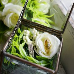 White flower ring bearer in a glass box #wedding #ring #glass #box