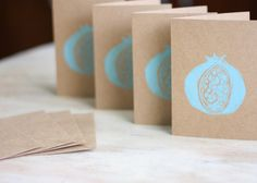 Blank Note Card Set of 4 Sea Glass Blue Pomegranate Block Lino Cut Stamped Hand Printed Brown Kraft Envelopes Holiday Gift Christmas. $9.00, via Etsy.