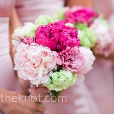 Bridesmaids bouquets made up of peonies in bright shades of pink while hydrangeas add a bit of green.