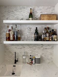 """Beautiful wet bar tile install by one of our customers! We 💗 this wet bar tile backsplash featuring our polished Carrara Venato marble mosaic tile in 1 x 2"""" mini brick / subway tile pattern. White marble with veins formed in wide waves. Tile Size: 12 x 12 in., 3/8"""" thick Uses: white marble backsplash, mini subway tile backsplash, white kitchen backsplash, wet bar tile ideas, white mini brick subway tile backsplash, brick shower wall tile, marble shower floor, white marble bathroom floor… Marble Bathroom Floor, White Marble Bathrooms, Marble Showers, Brick Tiles Kitchen, White Kitchen Backsplash, Backsplash Marble, Backsplash Ideas, Subway Tile Patterns, Brick Patterns"""