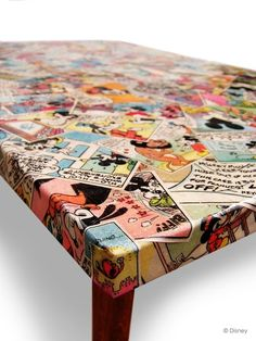 decoupage vintage comics onto a table.