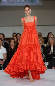 Tiered Gown : : : Among special occasion gowns, a tiered empire-waisted number is always a standout with its elegant double-ruffled flounce. In coral silk taffeta, it's unmistakably Oscar de la Renta.