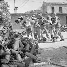 German troops on Rhodes hand in their gas masks, steel helmets and other military equiment following the signing of the unconditional surrender of German forces in the Dodecanese Islands.