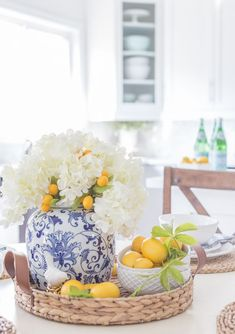 Luxury Outdoor Brands To Make The Best Of Your Summertime, Add the modern decor touch to your home interior design project! This Scandinavian home decor might just be what your home decor ideas is needing righ. Summer Table Decorations, Summer Centerpieces, Summer House Decor, Yellow Decorations, Decorated Jars, Tray Decor, Ginger Jars, Mellow Yellow, White Decor