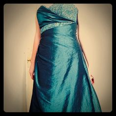 Flirt by Maggie Sottero Gown Teal floor length gown. Ruched on one side. Embellished with silver and blue beads. Bodice is corseted. Princess style skirt. Worn only once! Maggie Sottero Dresses Strapless