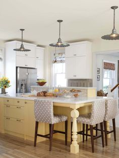 LIKES: Flat Cabinet Fronts 2 vertical cabinets instead of 1 (longer and shorter) Add a bench area to the end of kitchen island?