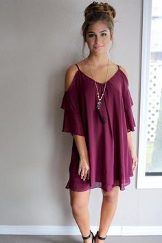 Charming cold shoulder dress with latered detail. Rich plum color.…
