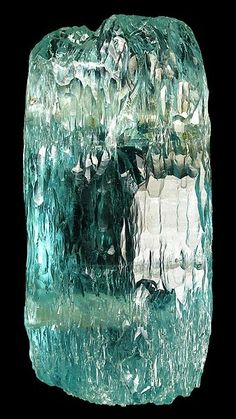 A water etched crystal of aquamarine from Brazil - Photo by Rob Lavinsky