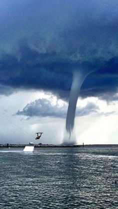 Quite a photo when the great waterski jump is barely noticed! This water spout was in Florida. 13 of these in one day while sailing from the Gulf back into Marathon Key Tornados, Thunderstorms, Severe Weather, Extreme Weather, Natural Phenomena, Natural Disasters, Cool Pictures, Cool Photos, Random Pictures
