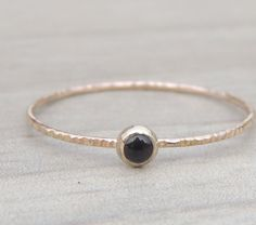Black Onyx 14kt Solid Gold ring // Delicate Black Gemstone Ring // made to order by NicoleScheetz on Etsy https://www.etsy.com/listing/200390457/black-onyx-14kt-solid-gold-ring-delicate