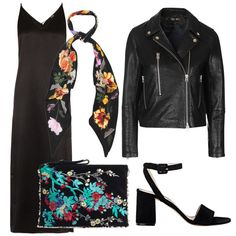 - Floral printed accessories pop against head-to-toe black.