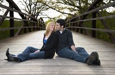 Couple sitting on bridge for #engagementphotos by BLY Photography
