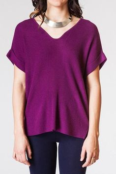 Short Sleeve Ruched Sweater Top ($72) When you want the warmth and comfort of a sweater, without the threat of overheating. Breathable fabric and short sleeves allow for versatile layering. A rounded v neck and ruched center seam give dimension without taking away from a flattering silhouette. Wear this bright fuchsia with Eggplant Skinny Jeans and boots for a colorful, funky fall look. Pair with one of our boho-chic statement necklaces or scarves for the perfect everyday look.