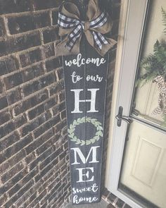 Painted in cracked pepper, featuring a green wreath and a buffalo check/burlap bow!