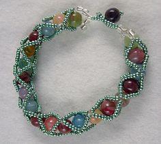 Criscross Beaded Bracelet Tutorial - maybe use smaller seed beads Love it! Must try! #ecrafty