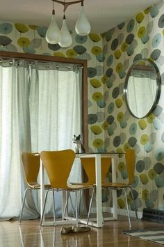 70s-tastic dining area. love the wallpaper.