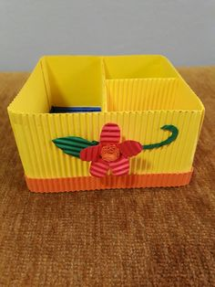 A box made of kokoru paper.  It can be used to put sticky notes, paper clip or the other common stuff in your cubical. You also can use it as a pin box to be put in your make-up table.