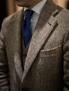 Light grey herringbone tweed jacket, white shirt with blue dress stripes, royal blue tie with white pin dots