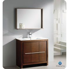 The Fresca 36-inch Allier is a sleek, modern free standing vanity with plenty of storage space. This set is accented nicely with a matching mirror with small shelf with a perfect balance of hues and textures.