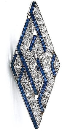 An Art Deco diamond and sapphire brooch, circa 1930. The brooch set with�