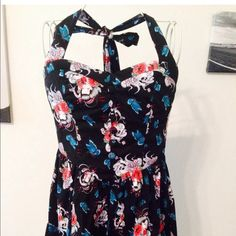 He'll Bunny yogi dress Hell Bunny Yogi Dress  The Yogi mini dress from Hell Bunny features halter straps, a side zip and an allover print of geisha heads with flowers, butterflies and skulls. Hell Bunny Dresses