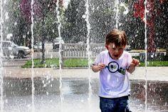 Playing in a fountain in Portland, Oregon