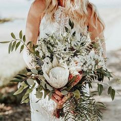 Stunning white protea bouquet Photography by: @karraleighphoto via @weddingchicks Flower arrangement : @mackfloraldesign Wedding planner/styling by: @kristenkellysdesigns #wedding #bouquet #protea #weddingbouquet #weddinginspiration #modernbride #bohobride #pinterestwedding #weddinginspiration #montrealwedding #montreal #bouquet #bouquetdefleurs #flowers #wedding #weddingflowers #weddingphotographer #weddingflowerarrangements