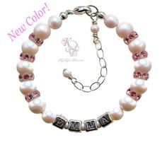 SHOP NOW: https://www.etsy.com/listing/271690332/pink-baby-bracelet-personalized-baby This precious baby bracelet is made with the beautiful Swarovski Iridescent White Pearl color, which was just released this spring. Soft pink Swarovski crystal rondelles space the pearls and baby's name is spelled with unique rounded edge sterling silver letters. These small letters were designed for specific use in baby and children's jewelry. For a lasting keepsake and loving gift, this baby bracelet…