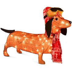 Improvements Lighted Tinsel Dachshund with Goggles Outdoor Christmas... (5.670 ISK) ❤ liked on Polyvore featuring outdoor christmas decor and christmas dogs