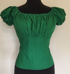 https://www.etsy.com/es/listing/480943320/vintage-1950s-inspired-green-fitted?ref=shop_home_active_21