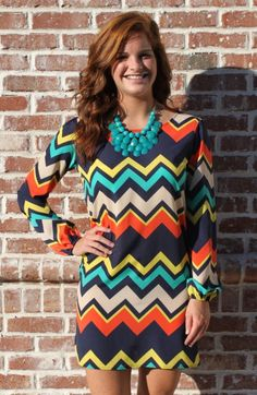 Now here is one little dress that will have everyone checking you out! The chevron print has some awesome fall colors that we here at Genealogy are seriously going crazy over! The fit of this dress is perfect as it really shows off your figure!