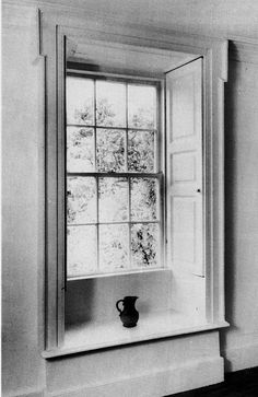 'A typical 18th century window, with lugged architrave, panelled shutters and window seat.'    I am enchanted by built in, panelled window shutters.