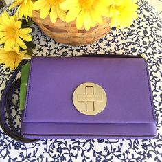 "Kate Spade Newbury Lane Sally Crossbody This little bag is a beautiful shade of purple (aster) Made out of Saffiano textured leather. Perfect for on the go when you don't want to lug around a big bag. Has 1 inner slip pocket and inner fabric lining with signature black and white pattern. Style# WKRU2256 Dimensions: Height=5.5"", Length=7.""n, Depth=1"", Strap=22"" *Dust bag included* kate spade Bags Crossbody Bags"
