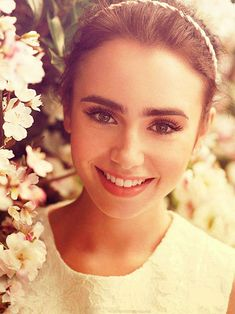 lily collins - eyebrow envy. Also nice wedding makeup?