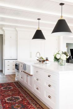 Gorgeous white kitchen design with black and red accents. farmhouse kitchen design with white kitchen cabinets, kitchen island with modern black kitchen pendant and boho runner Farmhouse Sink Kitchen, Kitchen Rug, New Kitchen, Kitchen Decor, Kitchen Cabinets, Kitchen Sinks, Kitchen Ideas, Modern Farmhouse, Kitchen Runner
