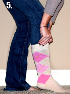 Tuck non skinny jeans into boots- I never thought about folding them then tucking them into a sock first