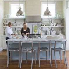 Lots of whites, greys, blues, green glasses, silver ... so refreshing!      Nautical chrome pendants and steel chairs add practicality to this airy space. Choose colors in hazy shades like this pool blue and warm vanilla to keep the room from looking fussy. The oversize island adds counterspace so there's plenty of room for several cooks in the kitchen.
