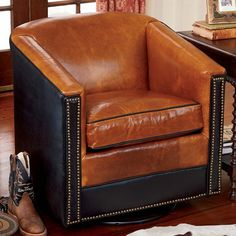 """Don't miss any of the action with the King Ranch Swivel chair. Made in Texas using Italian finished leather, it features a sturdy oak frame, smooth full swivel mechanism, studded contrasting leather front panel and an overstuffed down cushion for unparalleled comfort. 34""""W x 34""""D x 34""""H. Please allow 6-8 weeks for delivery. Made in USA.CURBSIDE delivery available: King Ranch Saddle Shop will deliver your selection to your curbside. There is no unpacking of the item by the deliver..."""