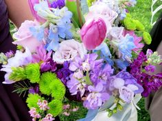 So pretty Spring bouquet with roses, tulips, stock, green button poms and delphinium.  Designed by Jen-Mor Florist in Dover, DE