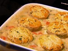 Chicken Stew with Biscuits. The photo does not do it justice. Feel free to cut back on the butter and cream. Her version might kill you.