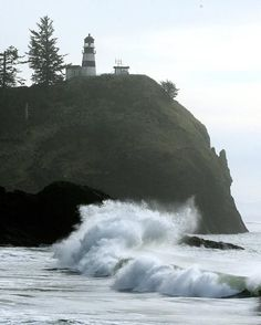 Great ocean views at Cape Disappointment Waves crash against the rocks below the Cape Disappointment Lighthouse