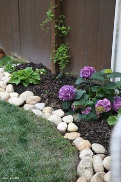 River Rock Planter Border - Ella Claire Spruce up and define your planters with this DIY River Rock Border River Rock Landscaping, Landscaping With Rocks, Front Yard Landscaping, Backyard Landscaping, Landscaping Ideas, Backyard Ideas, Sloped Backyard, Porch Ideas, Gardening With Rocks