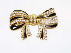 Large Rhinestone Bow Brooch with Clear by thejewelseeker on Etsy  #vintage #jewelry #teamlove