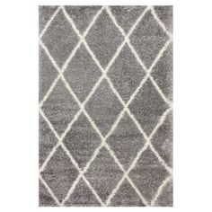 $99.95 for 4'x6'  Anchor your living room seating group or define space in the den with this stylish shag rug, featuring a diamond trellis motif for eye-catching appeal.