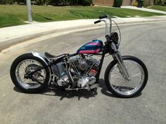 Shovelhead hardtail custom w/ pink & blue AMF tank and 41mm fork lowers