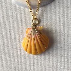 Made a sunrise shell gold triple wire wrapped necklace!