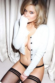 HELEN Flanagan may not have been crowned Queen of the Jungle, but she's certainly a winner in our eyes. The former Corrie actress, who became the fifth star to be voted out of I'm A Celebrity on Monday, looks sensational as she poses in a cute cardie and little else in the new FHM calendar. Helen, 22, who played Rosie Webster in the soap, displays her ample cleavage in the sultry snap by wearing nothing underneath her tiny white cardigan.