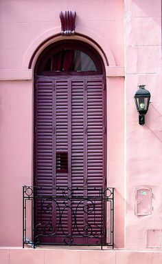 Aubergine Shutters on French Doors of Balcony. San Telmo, Buenos Aires, Autonomous City of Buenos Aires.
