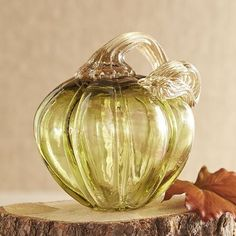 Whether it's the richness of the green color or the crackled rock-candy texture of the glass, our art pumpkin creates an inordinate amount of visual impact for its size.